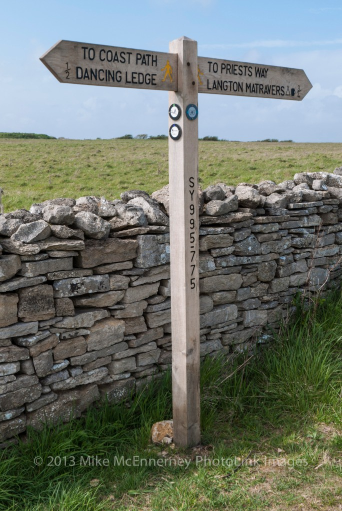 Signpost and drystone wall